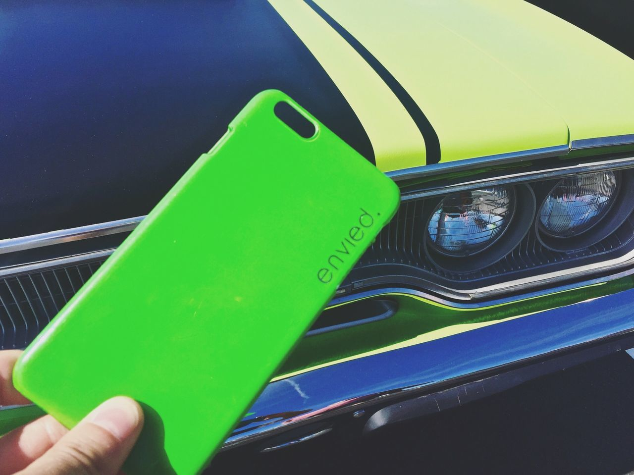 human hand, green color, car, one person, human body part, transportation, outdoors, land vehicle, day, close-up, real people, people