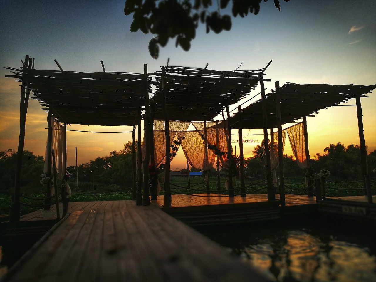 sunset, sky, outdoors, built structure, tree, roof, nature, no people, architecture, water, day