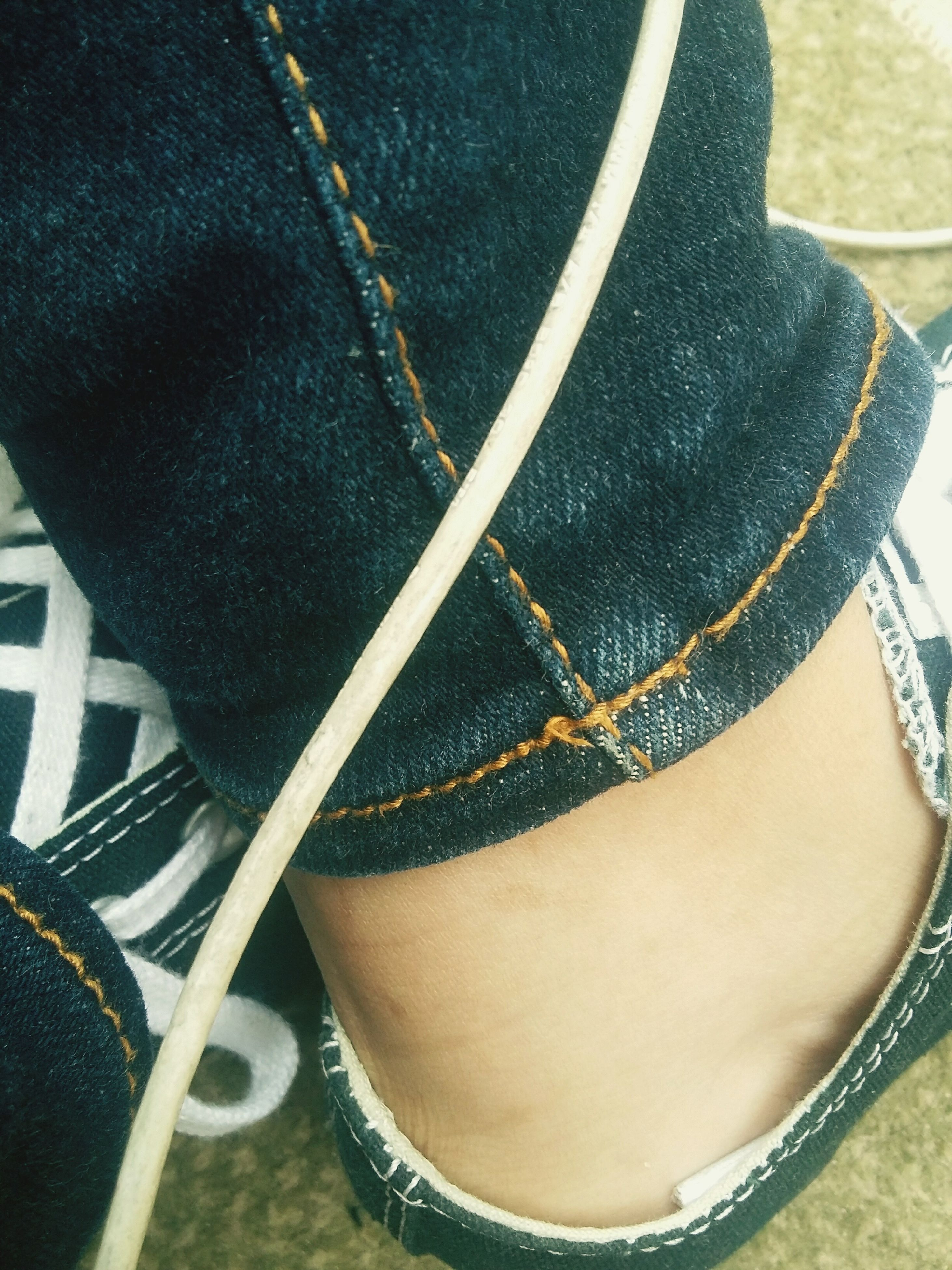 lifestyles, low section, person, fashion, leisure activity, close-up, part of, casual clothing, young women, personal perspective, standing, high angle view, shoe, wearing, young adult, focus on foreground
