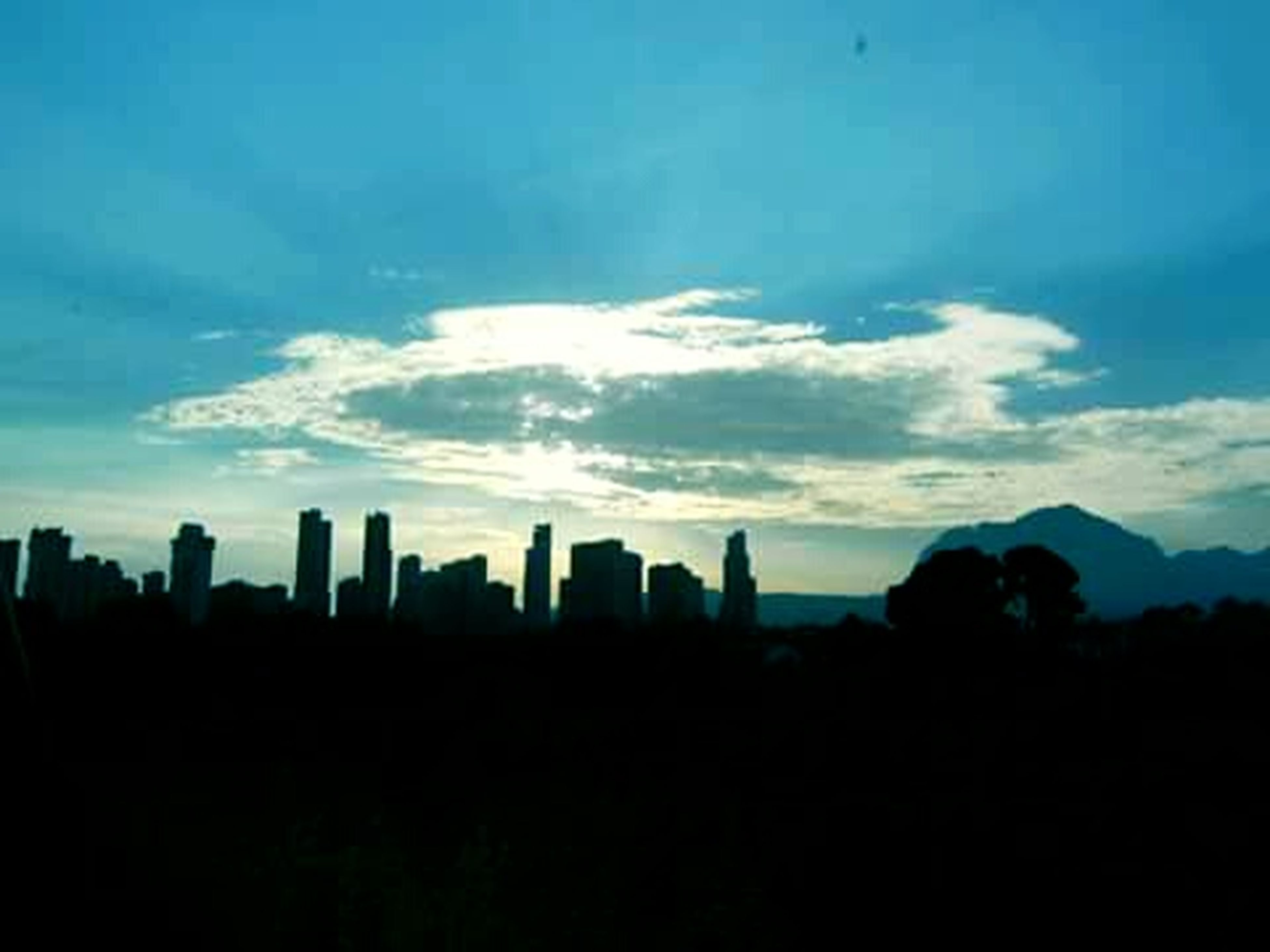 silhouette, building exterior, city, architecture, built structure, sky, cityscape, skyscraper, urban skyline, skyline, scenics, dusk, cloud - sky, cloud, outline, tree, copy space, outdoors, no people, nature