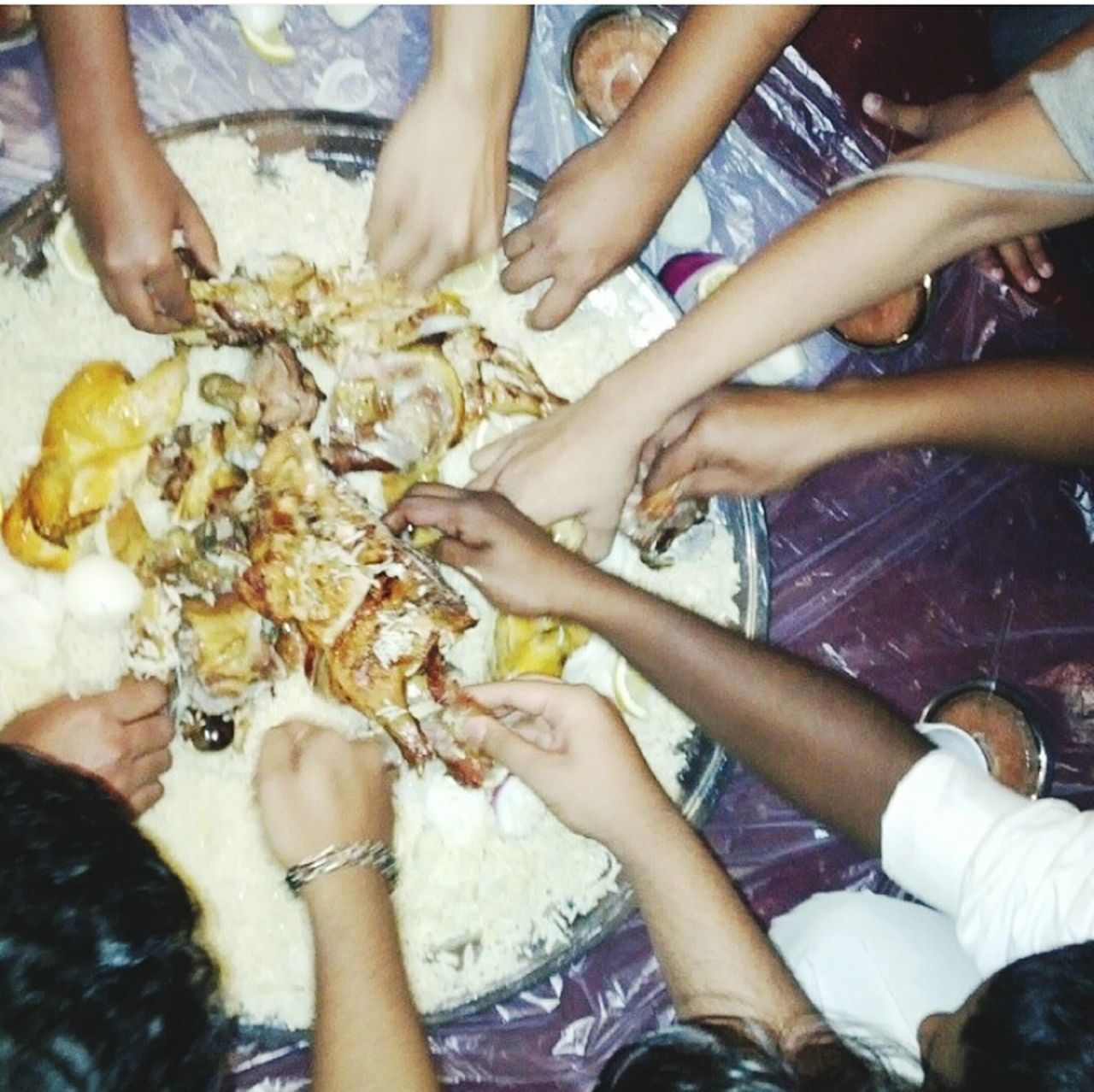 human hand, human body part, togetherness, real people, food and drink, lifestyles, fun, leisure activity, women, food, outdoors, friendship, day, group of people, low section, men, close-up, people, adult
