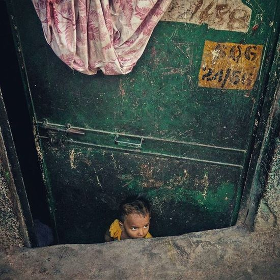 A young Indian boy peeks out of his house in the old quarters of Delhi, India. Everydayeverywhere Everydayindia Dailylife Photojournalism Journalism Reportage Reportagespotlight Cityofcities Huffpostgram Indiaphotoproject Dfordelhi Sodelhi DelhiGram Onepluslife Oneplus2 Myfeatureshoot Delhi Newdelhi ASIA India