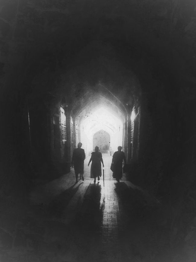The ancient City of Bukhara Uzbekistan, People and Places - Silk Road in Central Asia Blackandwhite Photography Bukhara Dark Diminishing Perspective Full Length Group Of People Illuminated Leisure Activity Lifestyles Silhouettes Silk Road Streetphotography The Street Photographer - 2016 EyeEm Awards The Way Forward Tunnel Uzbekistan Walkway