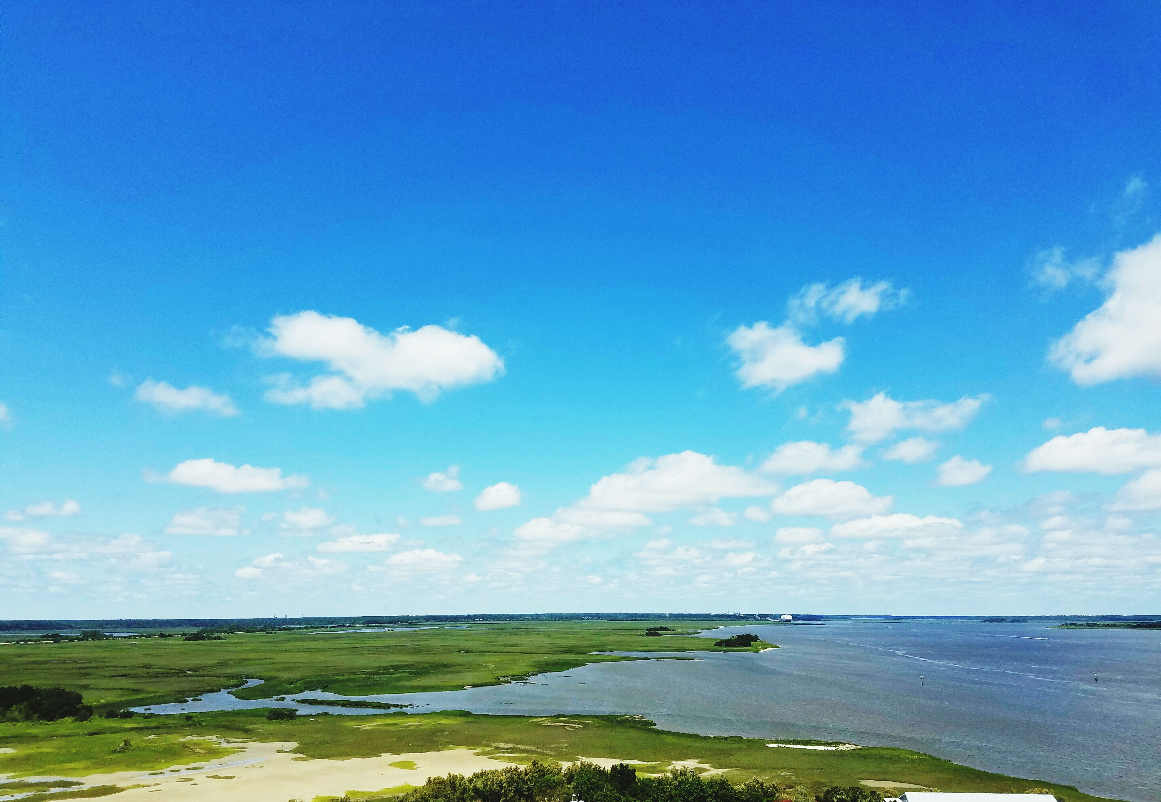 sea, tranquil scene, sky, blue, tranquility, water, horizon over water, scenics, beauty in nature, nature, grass, cloud, landscape, beach, idyllic, cloud - sky, day, coastline, field, remote