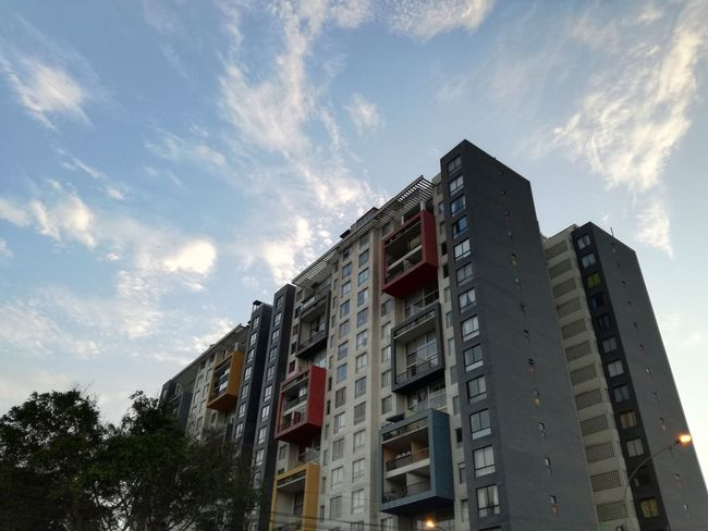 EyeEmNewHere Architecture Low Angle View Building Exterior Cloud - Sky Business Finance And Industry Built Structure No People Day Skyscraper Outdoors Sky City Modern Lanscape Photography Amazing View EyeEm Best Shots Eyem Select Architecture Artistic City Sunset_collection Nature Tranquility Moments