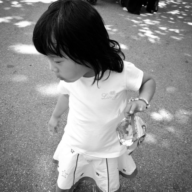 Monochrome Photography Little Girl Eating Snacks Childhood Captured Moment Street The Essence Of Real People Children Kids Capture The Moment Street Photo Streetphotographer Real People Street Photography Street Scenes Streetphoto People Around You Black And White Black And White Photography Bnw_captures Close Up Street Photography