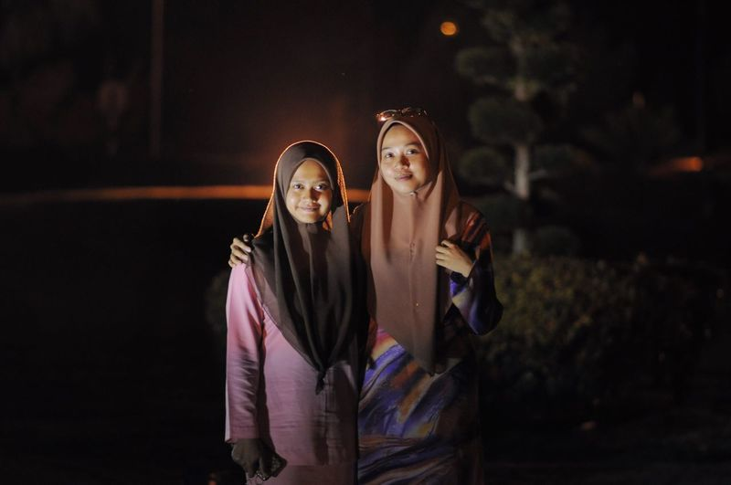 Real People Night Young Women Young Adult Togetherness Lifestyles Leisure Activity Two People Wireless Technology Holding Mobile Phone Communication Standing Friendship Smiling Happiness Outdoors Beautiful Woman People The Portraitist