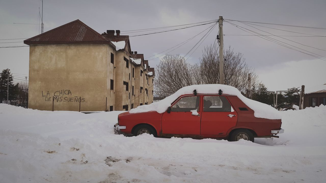 Car Parked On Snow Covered Street