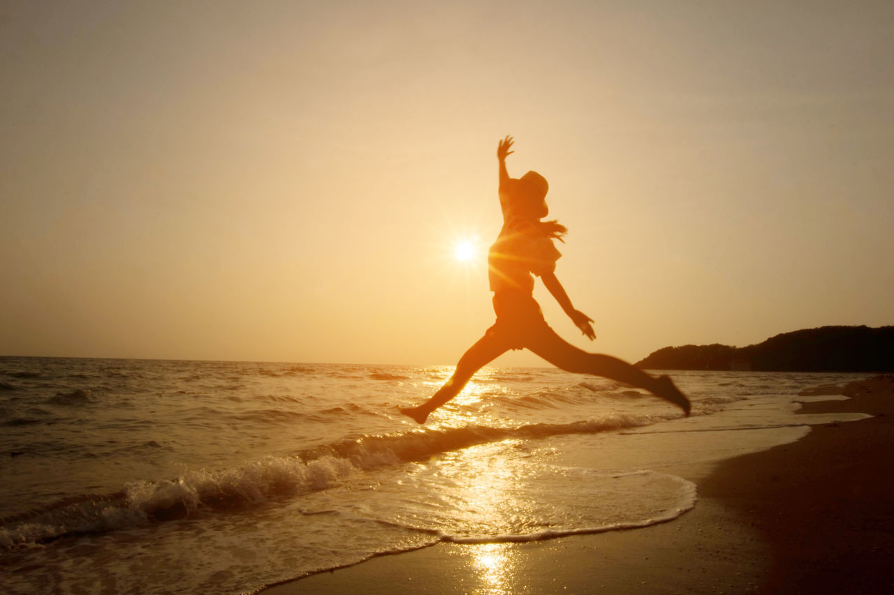 Beach Beautiful People Beauty Beauty In Nature Cheerful Freedom Fun Happiness Healthy Lifestyle Horizon Over Water Human Body Part Joy Jumping Lifestyles Outdoors Sea Sky Sport Summer Sun Sunlight Sunset Teenager Vacations Women