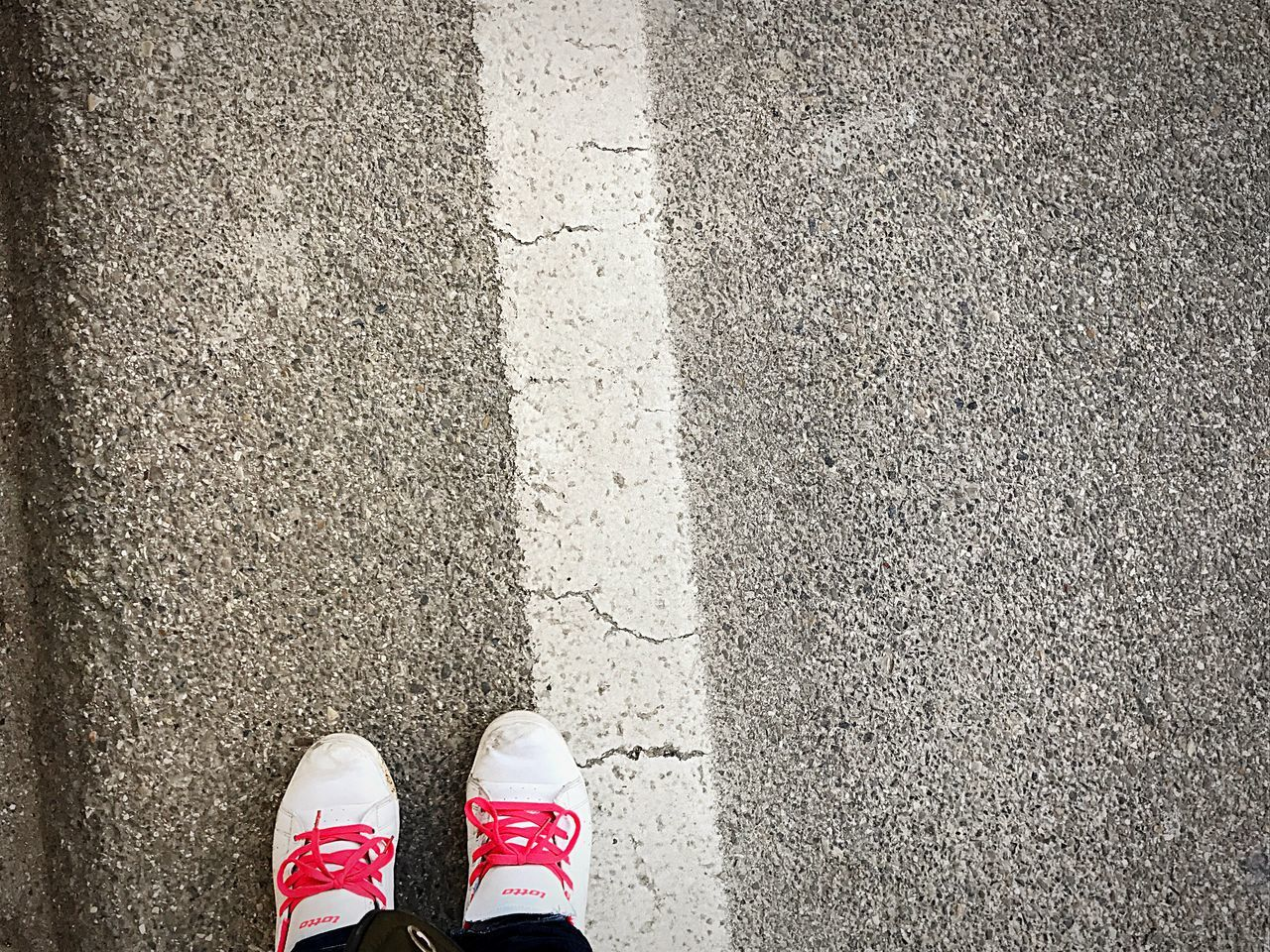Low Section Human Leg Shoe Standing Street Road One Person Human Body Part Real People Outdoors Leisure Activity Asphalt Day People Adult Canvas Shoe Close-up Adults Only Borderline Border LINE
