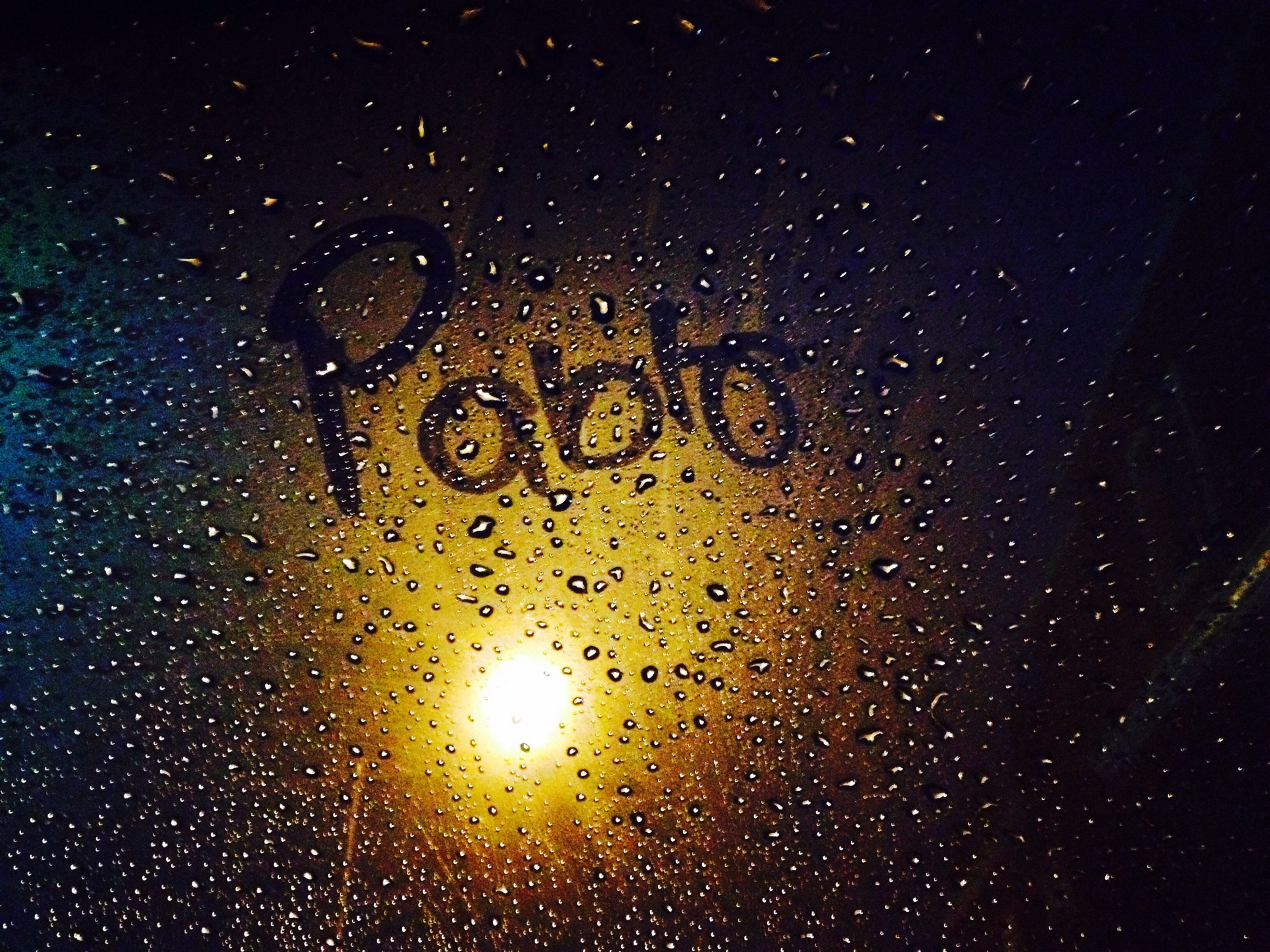 night, indoors, full frame, wet, backgrounds, drop, close-up, glass - material, rain, water, transparent, dark, window, illuminated, no people, communication, raindrop, text, astronomy, western script