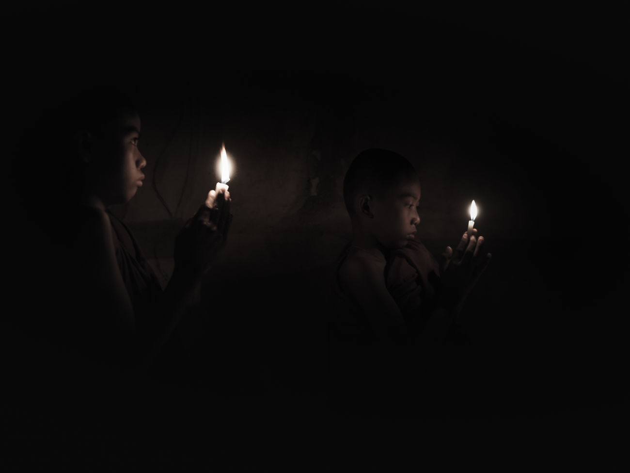 Black Background Burning Candle Dark Darkroom Flame Heat - Temperature Illuminated Night Novice Novice Monks One Person People Smoke - Physical Structure Young Adult