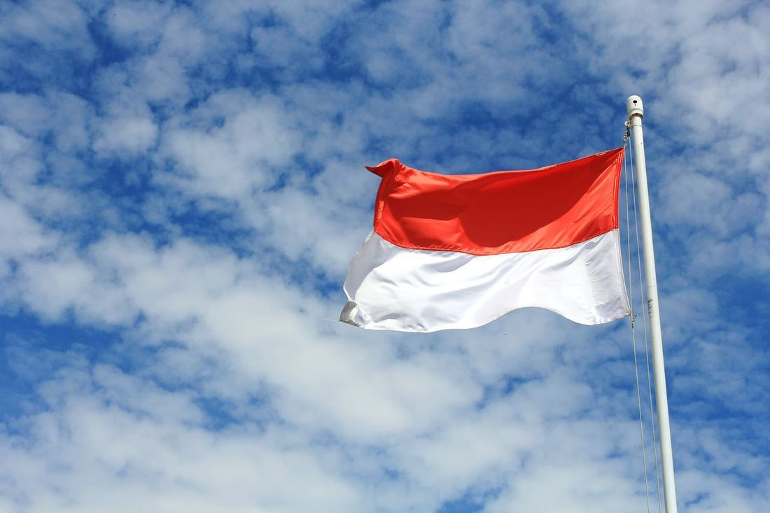 Indonesian flag Red Flag Low Angle View Cloud - Sky Sky Day No People Patriotism Outdoors Nature Red And White Indonesia Flag Nationalsm Flying Blue Sky Clear Pancasila