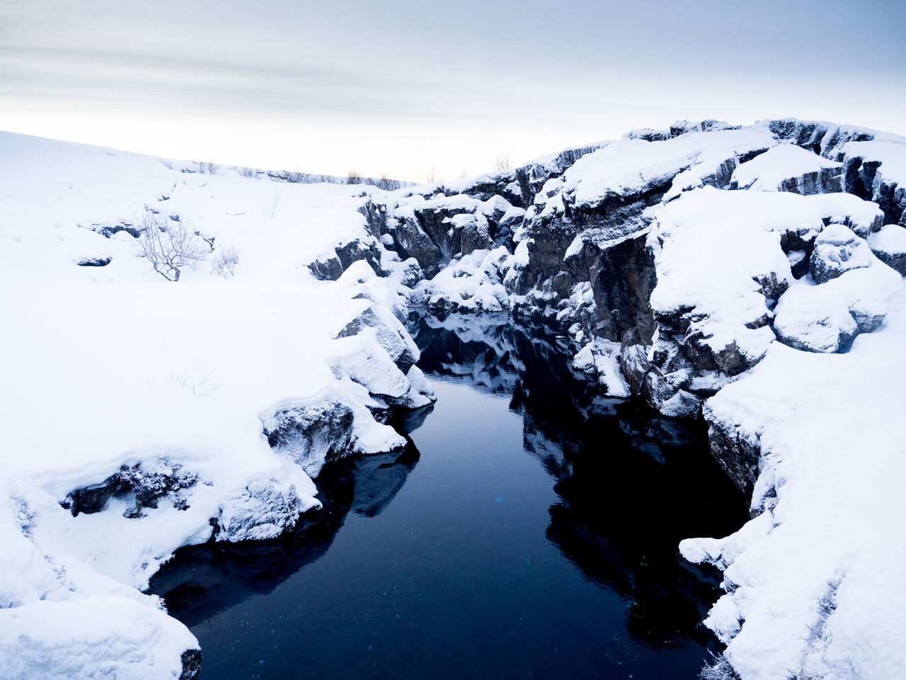 Beauty In Nature Cold Temperature Covering High Angle View Iceland Idyllic Landscape Majestic Mountain Mountain Range Nature Non-urban Scene Remote Rock - Object Scenics Season  Sky Snow Snowcapped Mountain Solitude Tranquil Scene Tranquility Water Weather Winter