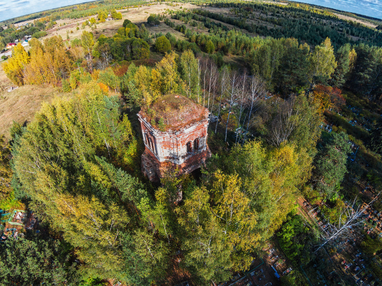 Aerial view of an abandoned church and cemetery A Bird's Eye View Abandoned Abandoned Church Aerial Aerial View Architecture Beauty In Nature Built Structure Close-up Day Green Color Growth Landscape Nature No People Outdoors Plant Top Perspective Tower Tree