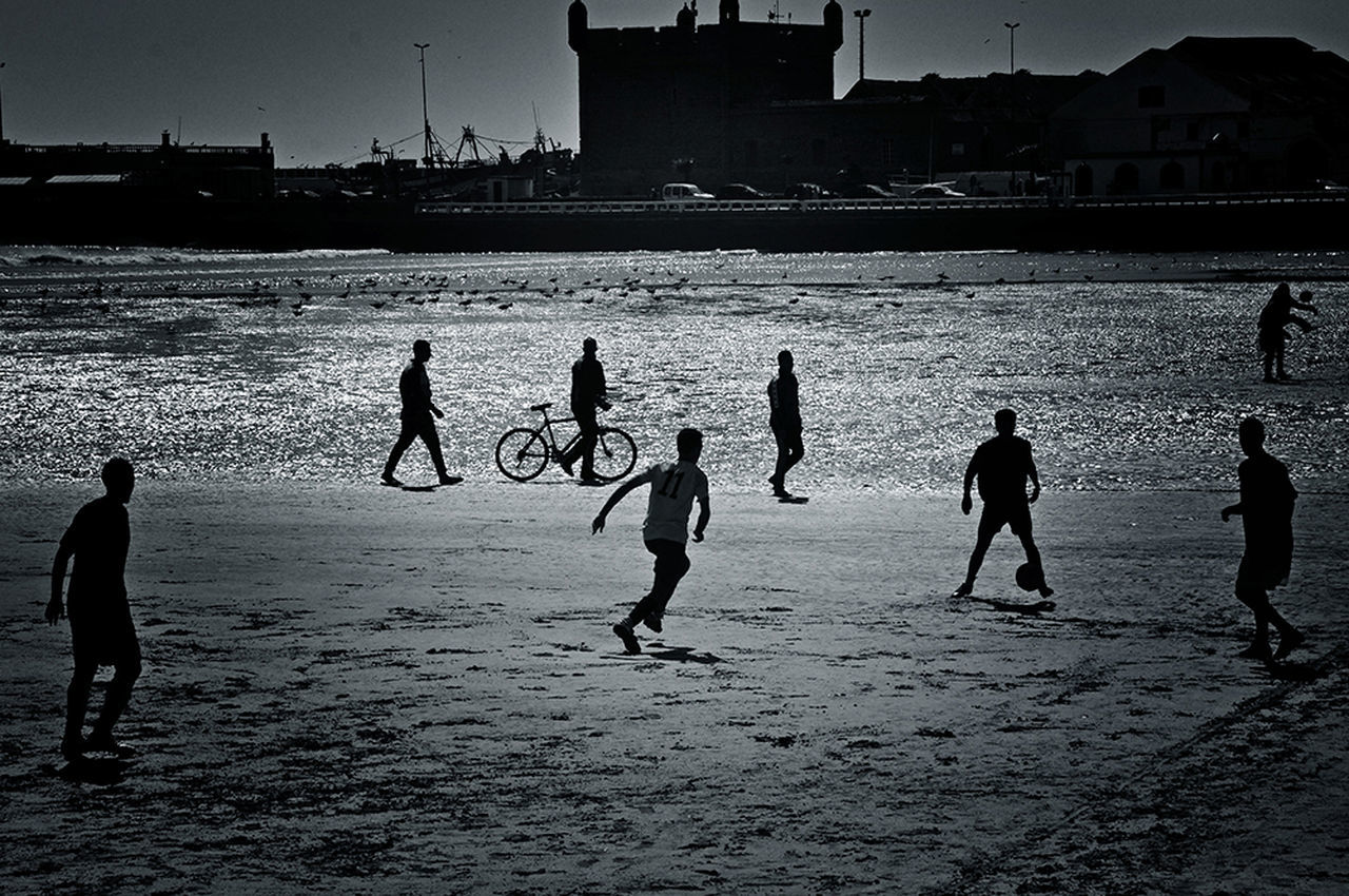 Football Fever Blackandwhite Photography Improvised Football Pitch On The Beach Football Is Here By The Sea Football Field On The Sand Black&white Localscene Local Culture People Playing Football Enjoying Life Football Time  Footballislife Creative Light And Shadow Malephotographerofthemonth Football Game Sports Sport In The City Football Sports Photography - Morocco