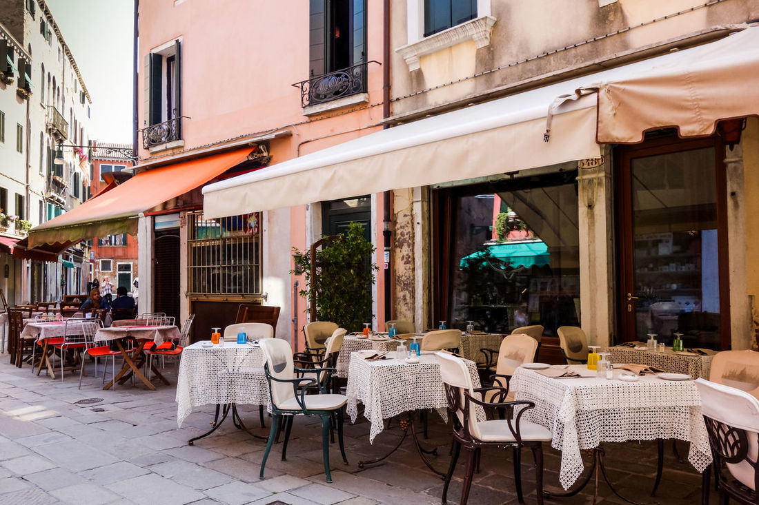 Architecture Awning Building Exterior Built Structure Cafe Chair City Day Food Food And Drink Industry Large Group Of People Outdoor Cafe Outdoors People Place Setting Real People Restaurant Restaurants Seat Sidewalk Cafe Table