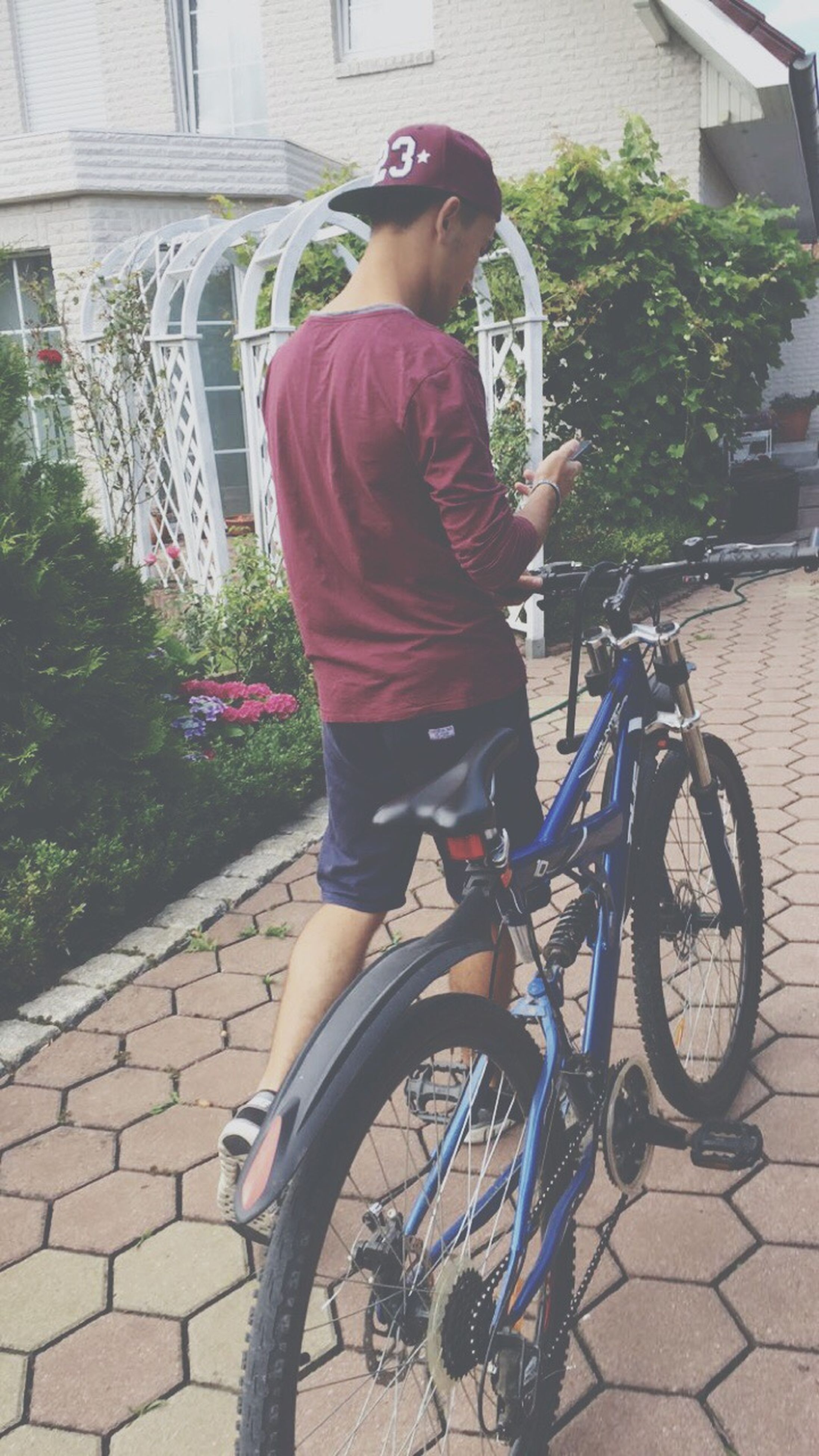 bicycle, outdoors, one person, full length, day, real people, architecture, tree, city, people
