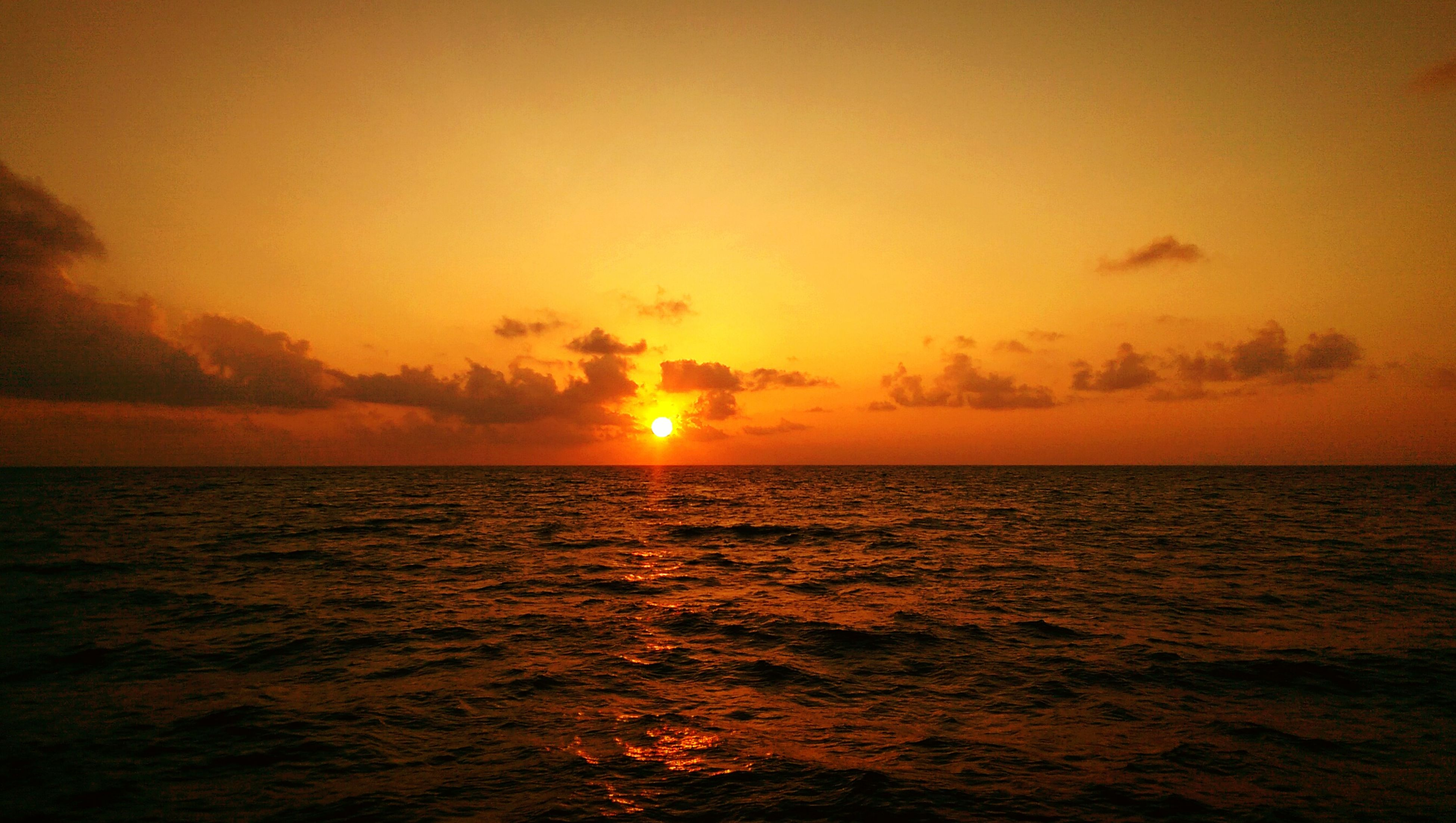 sunset, sea, water, scenics, horizon over water, sun, tranquil scene, beauty in nature, orange color, tranquility, sky, idyllic, waterfront, nature, reflection, rippled, seascape, sunlight, cloud - sky, outdoors