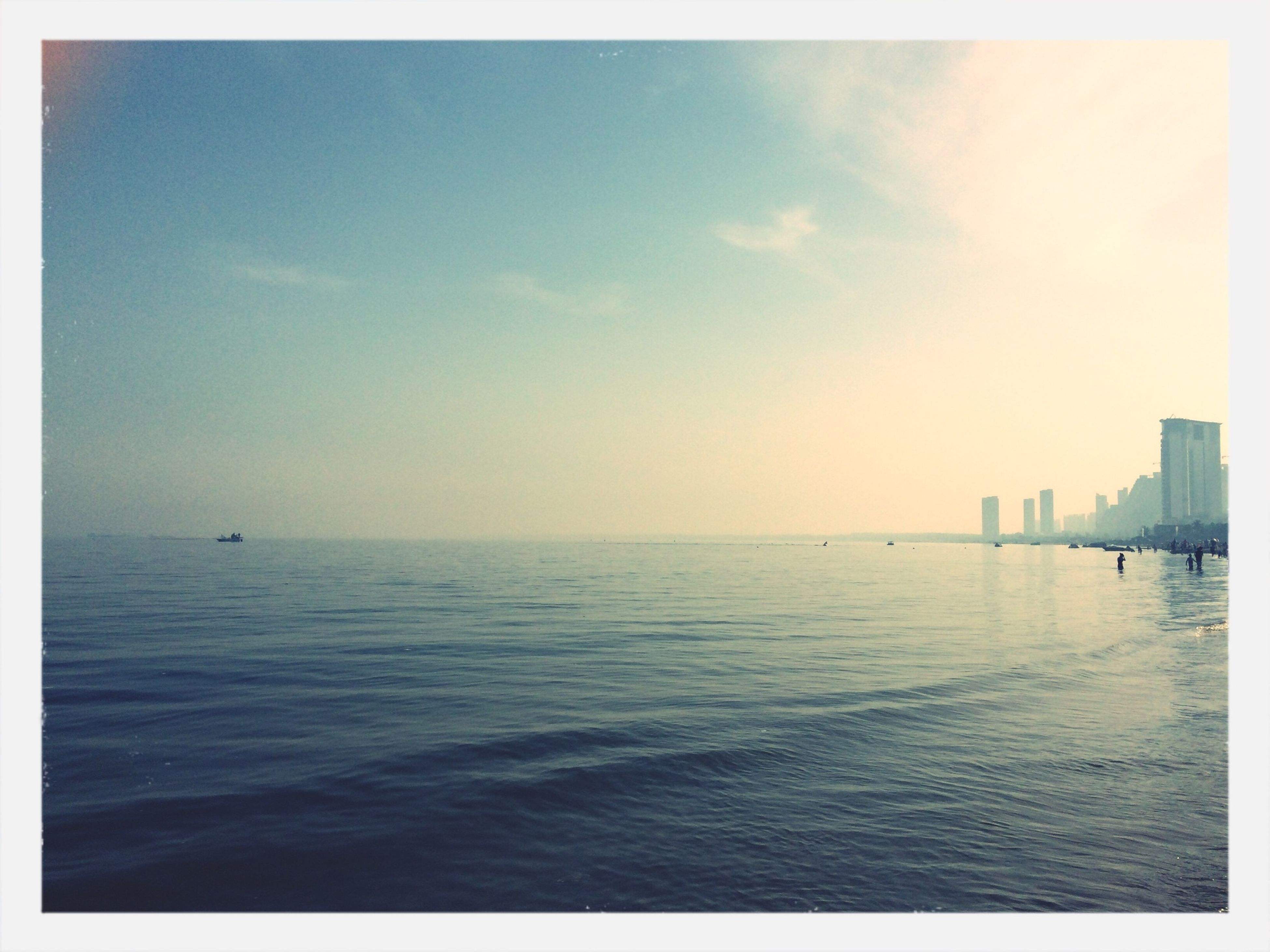 sea, water, horizon over water, scenics, tranquil scene, transfer print, tranquility, waterfront, sky, beauty in nature, auto post production filter, nature, idyllic, sunset, rippled, seascape, outdoors, calm, built structure, ocean