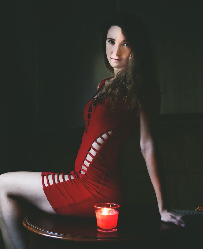 Young Women Lifestyles Young Adult Real People One Person Looking At Camera Leisure Activity Red Holding Beautiful Woman Standing Indoors  Illuminated Technology Day Indoors  Focus On Foreground Red Fancy Red Dress Sitting Candellight