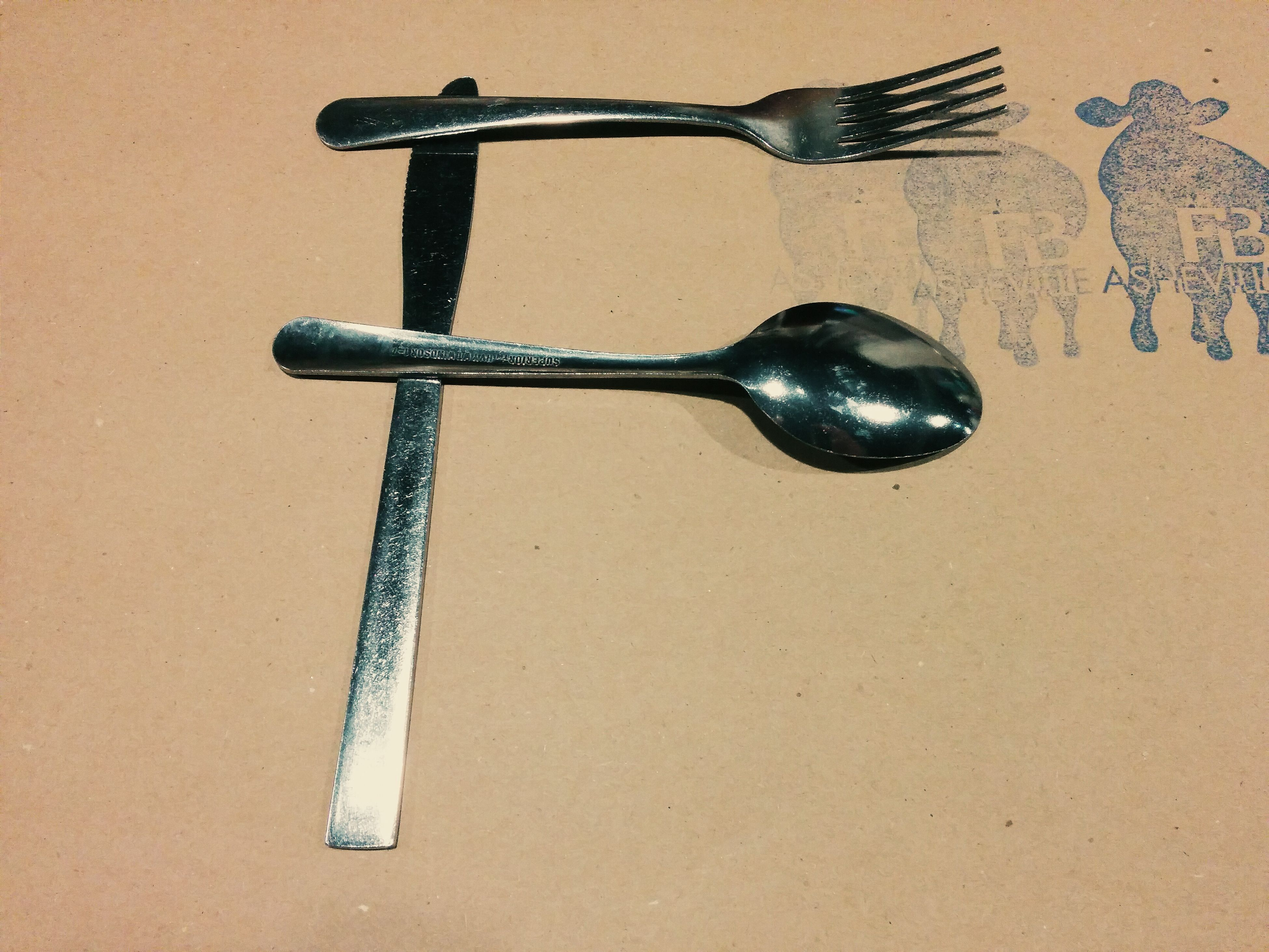 still life, metal, indoors, close-up, metallic, high angle view, single object, equipment, work tool, studio shot, no people, table, wood - material, old, man made object, two objects, directly above, wall - building feature, spoon, day