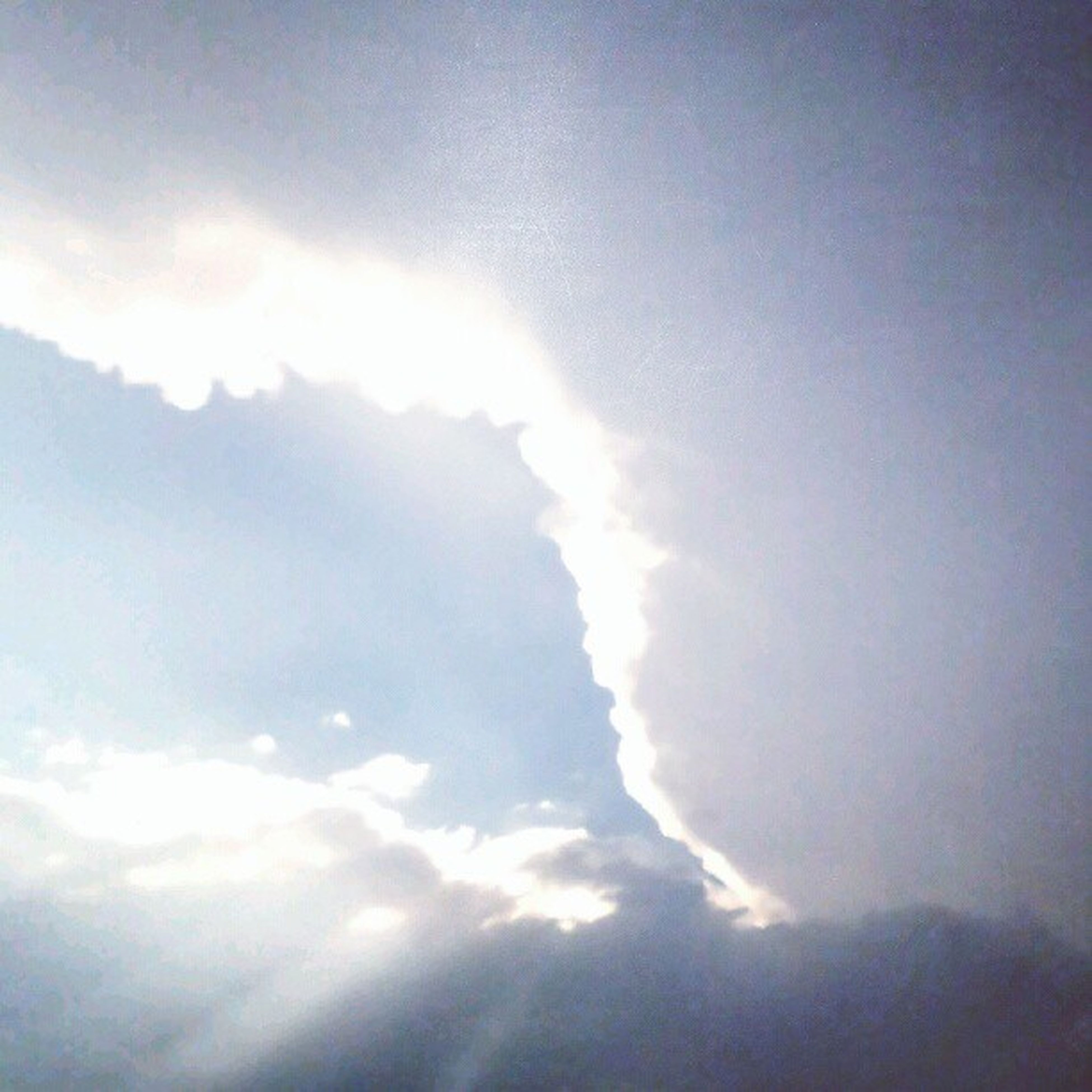 sky, cloud - sky, low angle view, beauty in nature, scenics, sky only, cloudy, tranquility, cloudscape, tranquil scene, nature, cloud, weather, idyllic, sunbeam, outdoors, overcast, sunlight, majestic, blue