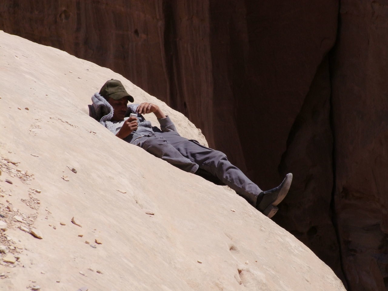 Jordanian Resting in a Hollow in Sandstone Cliff! Bedouin Cliff Edge Composition Dangerous Famous Place Full Frame Jordan Jordanian Leisure Activity One Man Only One Person Outdoor Photography Petra Resting Place Sandstone Rock Formation Sleeping Smooth Rocks Sunlight And Shade Tourist Attraction  Tourist Destination Unusual Waiting