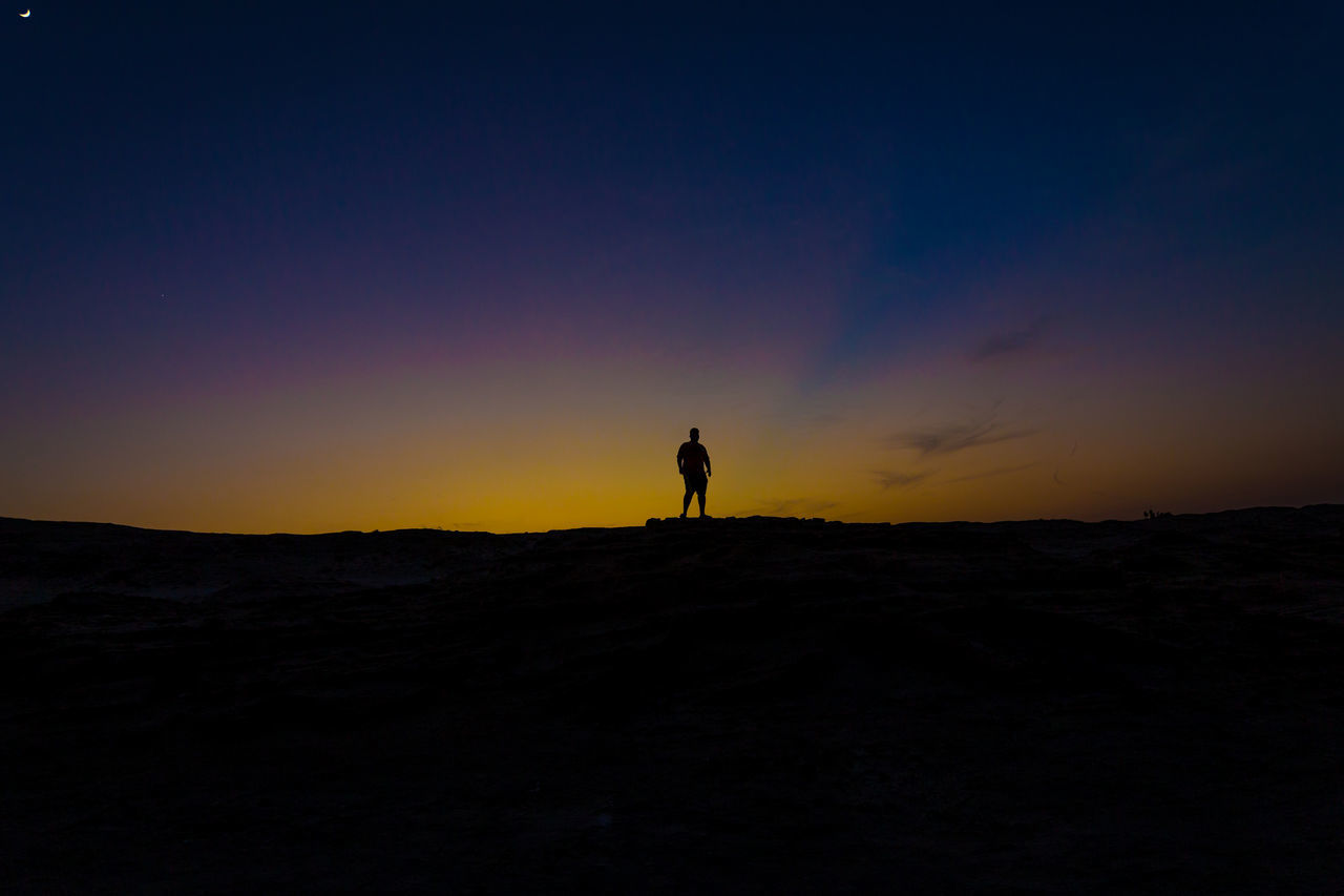 Adult Adults Only Adventure Beauty In Nature Exploration Full Length Hiking Landscape Nature Night One Man Only One Person One Young Man Only Only Men Outdoors People Rear View Silhouette Sky Sunset Tourism Travel Travel Destinations Vacations Young Adult