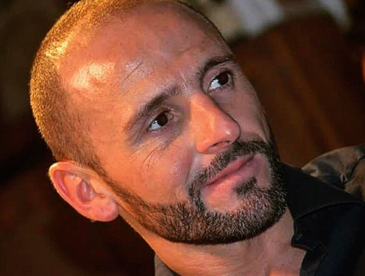 only men, beard, one man only, headshot, portrait, adults only, one person, mid adult, adult, hair loss, close-up, looking at camera, indoors, people, mature adult, human face, mustache, shaved head, men, human body part, day