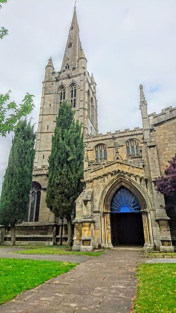 Architecture Religion Built Structure Building Exterior Church Place Of Worship Spirituality Arch Cathedral Entrance Tower Low Angle View Travel Destinations History Façade Outdoors Sky Lawn Spire  Day