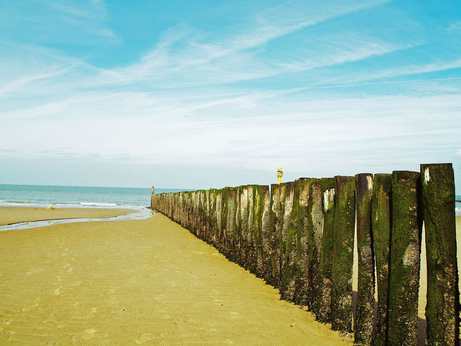 Beach Beauty In Nature Boundary Bulwark Calm Day Fence Horizon Over Water Idyllic Nature Non-urban Scene Outdoors Remote Scenics Sea Shore Sky The Way Forward Tranquil Scene Tranquility Travel Destinations Water