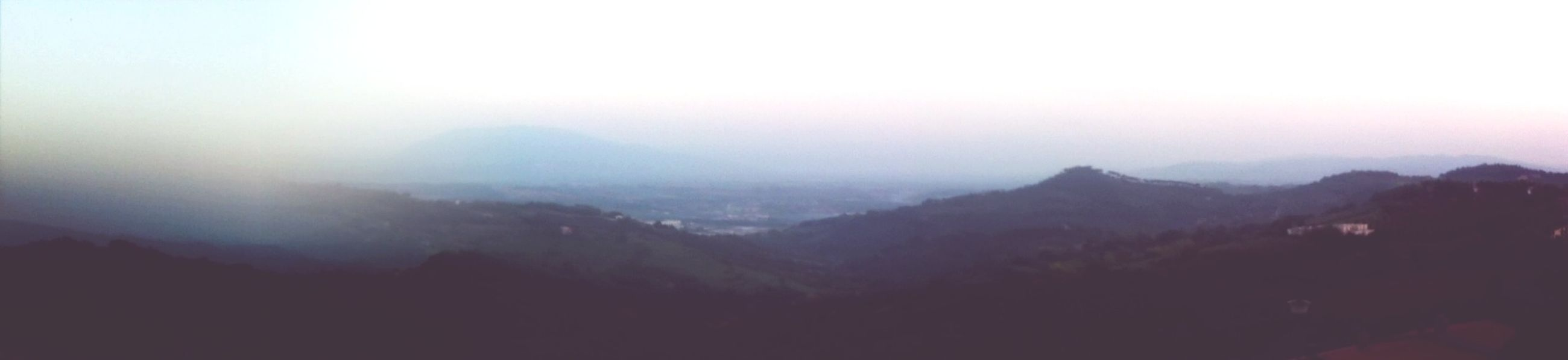mountain, fog, tranquil scene, scenics, tranquility, beauty in nature, mountain range, foggy, landscape, nature, copy space, sky, idyllic, silhouette, weather, tree, non-urban scene, outdoors, no people