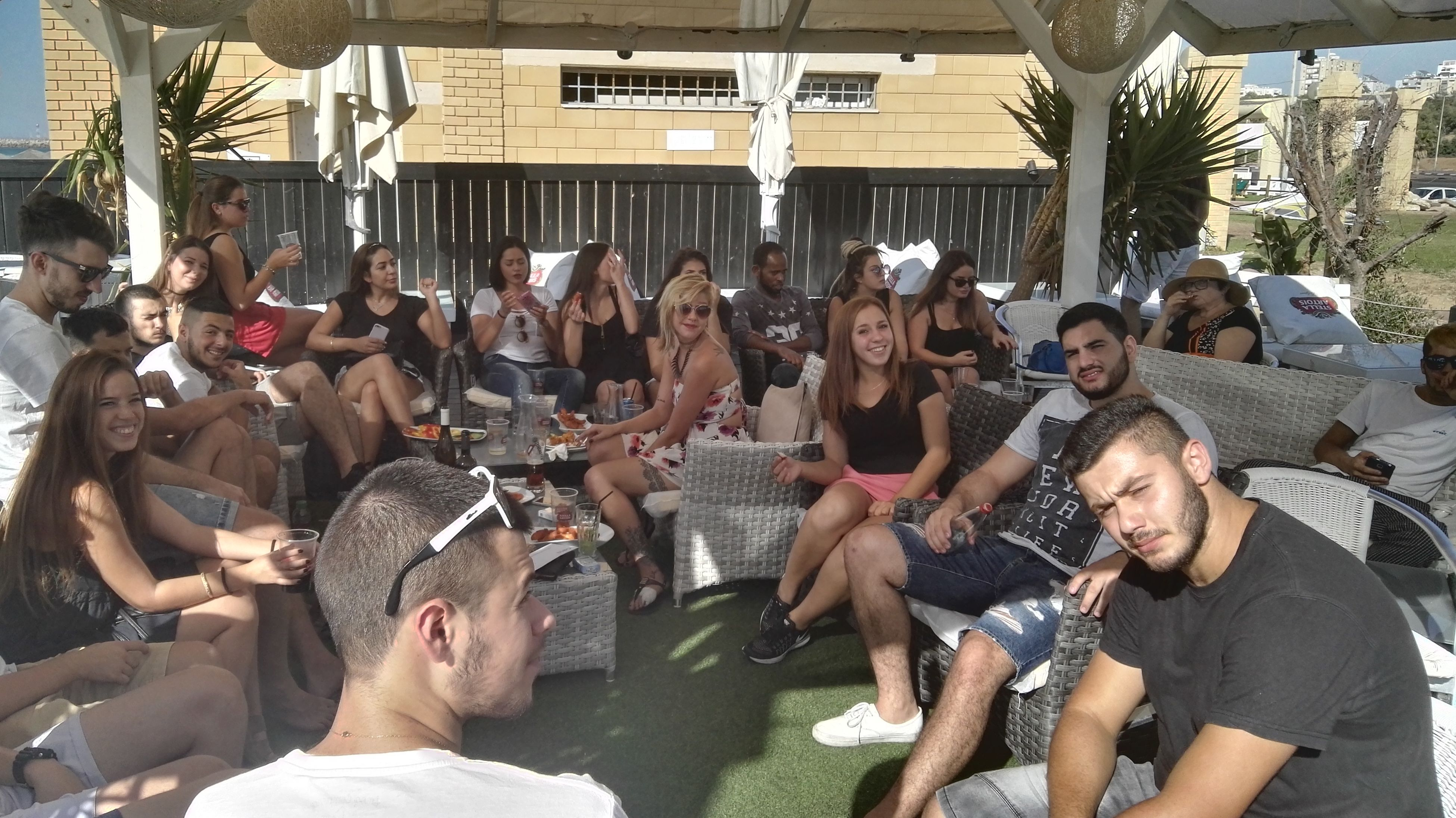 leisure activity, lifestyles, togetherness, casual clothing, large group of people, friendship, person, fun, crowd, young adult, in front of, enjoyment, holiday - event, outdoors, performance