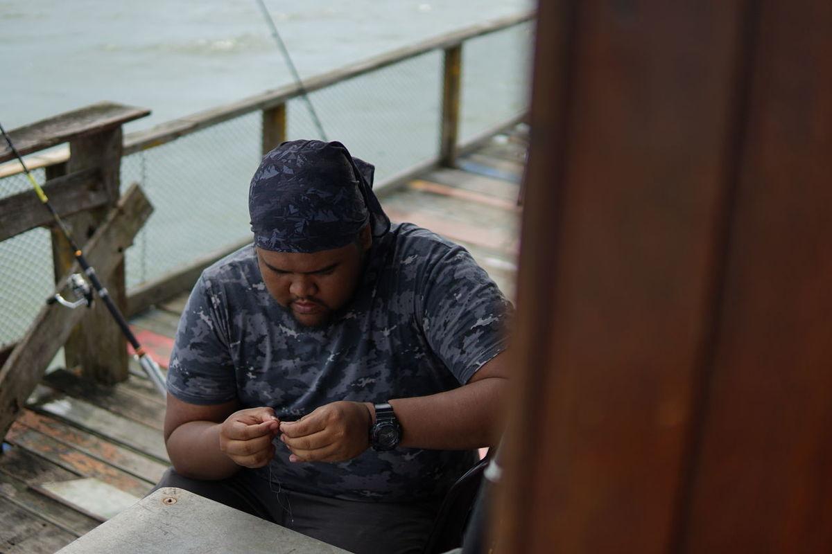 Bait Fishing Holding Lifestyles Malay Malaysia Malaysian One Person People Real People Rod Telok Gong