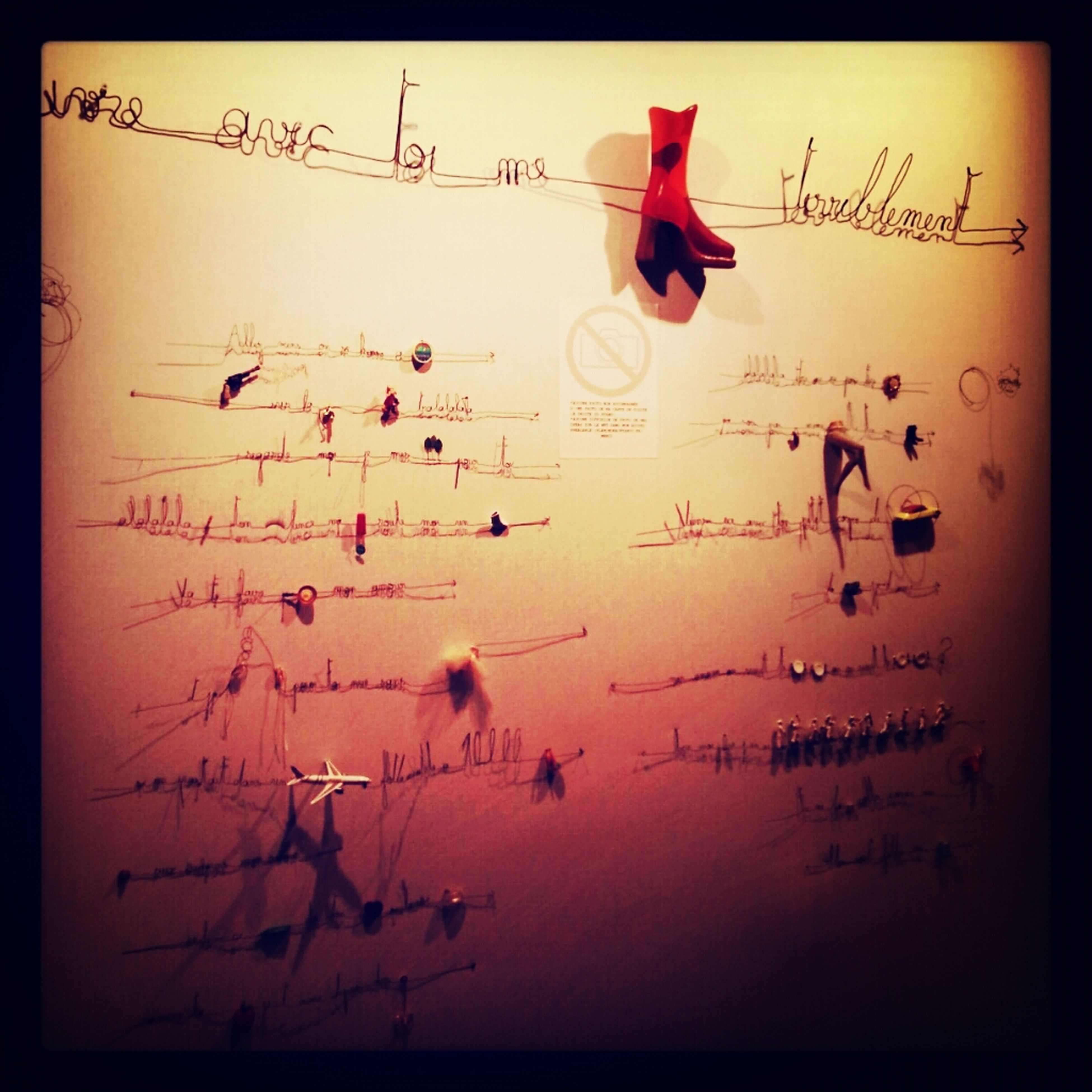 transfer print, auto post production filter, text, western script, communication, indoors, paper, close-up, no people, art and craft, variation, creativity, studio shot, hanging, vignette, large group of objects, still life, red, ideas, wall - building feature