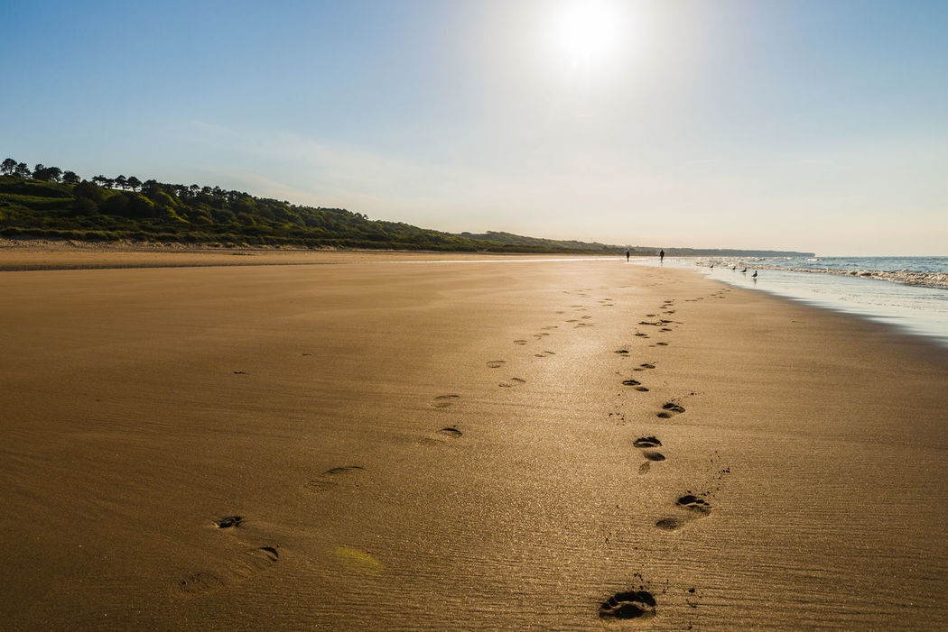 A photo from Omaha Beach in Normandy. Backlit Beach Coastline Day Flare Footsteps Footsteps In The Sand France Historical Sights History Landscape Nature Normandie Normandy Omaha Beach Outdoors Sand Scenics Sea Sky Sun Sunlight Tranquility Water World War 2