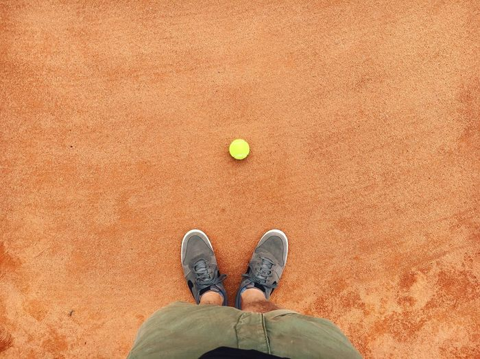 Tennis Tenniscourt Low Section Tennis Ball Human Leg One Person Shoe Directly Above High Angle View Standing Day Tennis Racket Sport Sand Ball Real People Court Outdoors Racket Sport One Man Only Human Body Part Tennis 🎾 Tennis Ball Tennis Court Tennisball