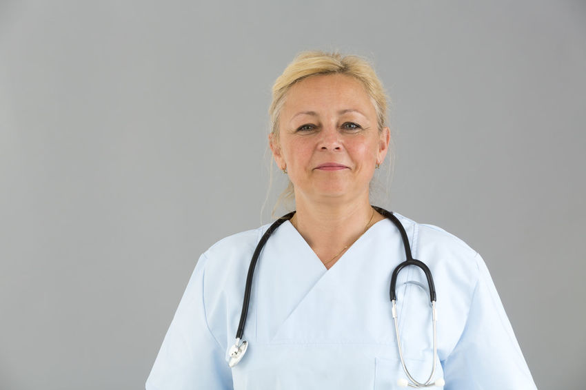 Stethoscope  Pediatrician Medical Portrait Hospital Pediatrics Doctor Reassurance Reassuring Clinic White Background Looking At Camera Looking To The Camera Front View Posing Medical Team Smiling Nurse Beautiful Woman Reassure Trust Selfconfident Self Confident Self Confidence