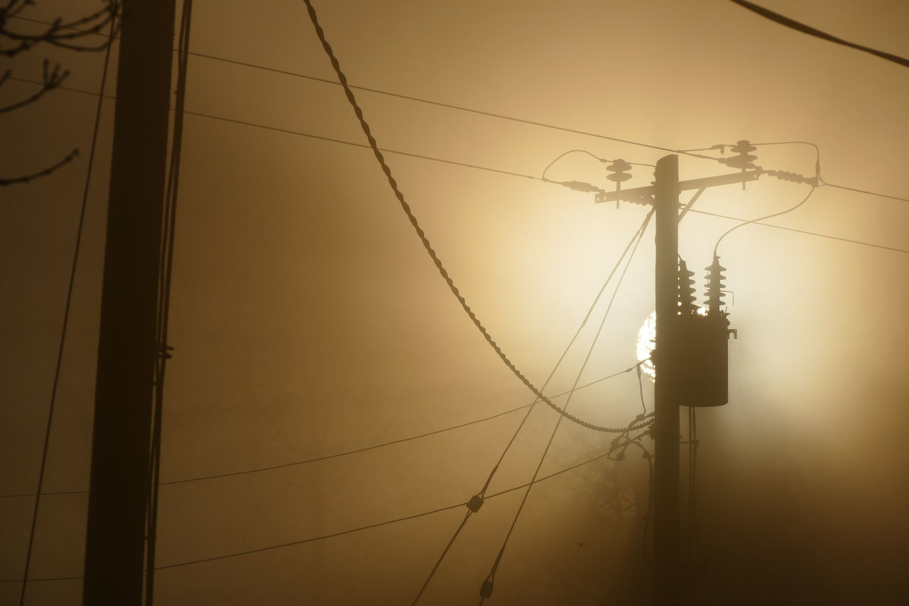 Foggy day.. Cable Connection Day Dream States Electricity  Electricity Pylon Ethereal Fog Foggy Foggy Weather Low Angle View No People Outdoors Power Line  Power Supply Silhouette Silhouette_collection Sky Softness Sun Sunset Telephone Line
