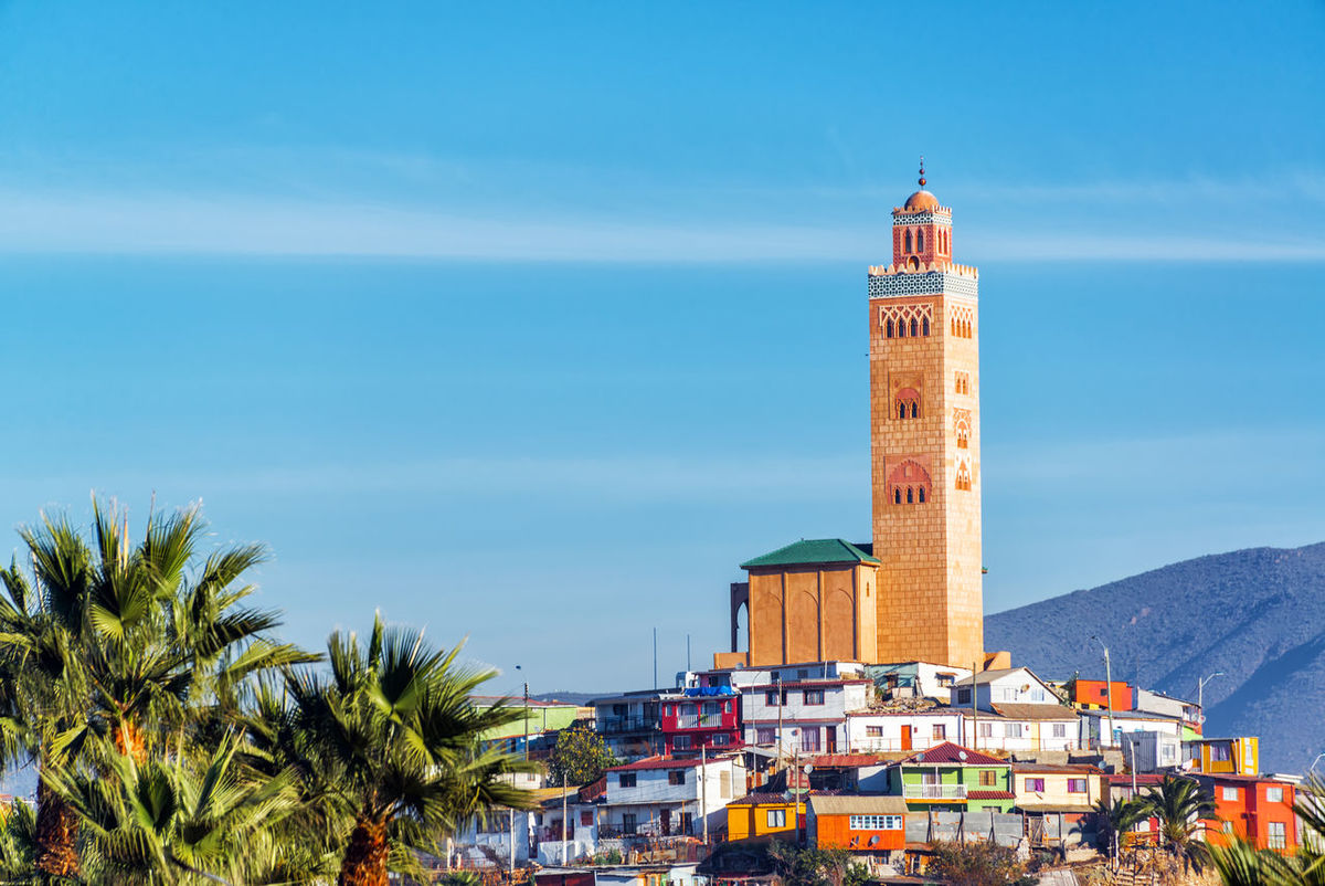 Mosque on top of a hill with houses in Coquimbo, Chile Arabic Architecture Brick Bulding Chile Coastal Concrete Coquimbo Faith Façade Hillside Houses Islam Minaret Mosque Mosques Muslim Palm Tree Religion Slums Style Tourism Tower Tree View