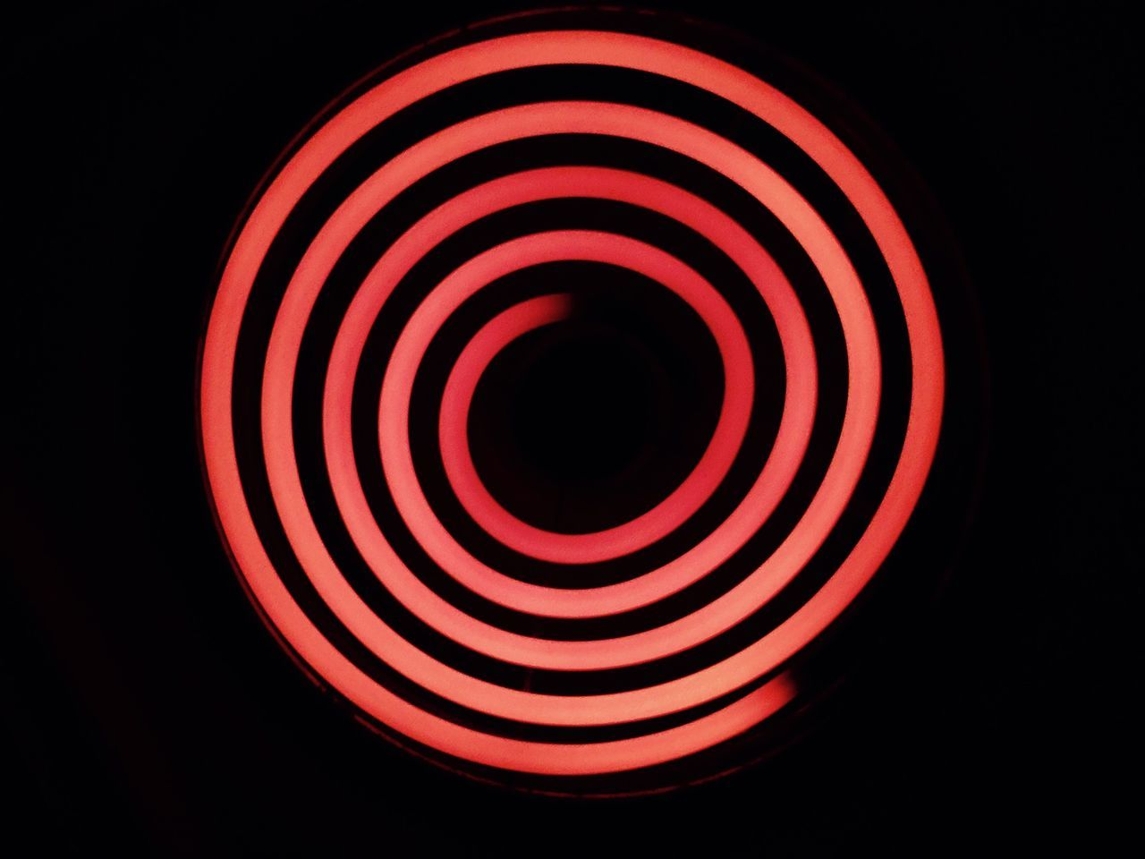 Circle Night Spiral Red No People Black Background Close-up Concentric Outdoors High Angle View Stove Stove Top Indoors