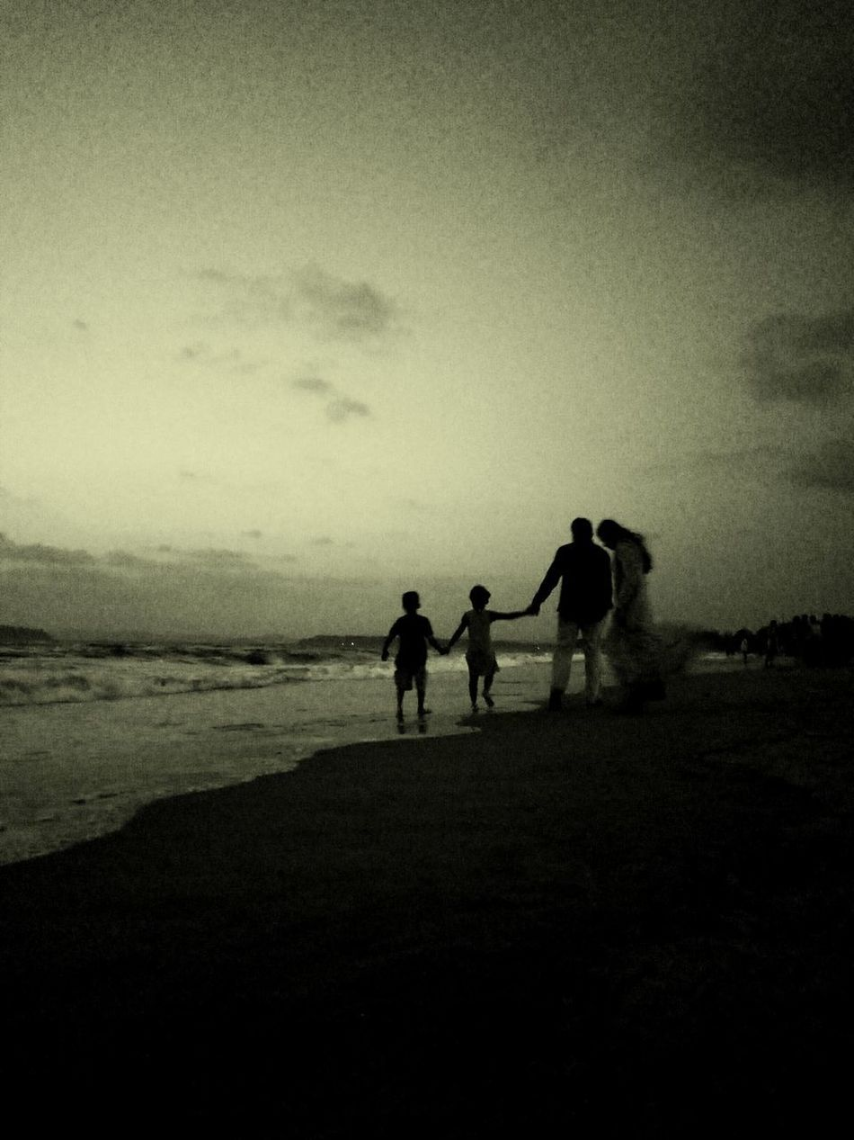 Beach Silhouette Sand Sea Togetherness Full Length Two People People Water Adult Child Outdoors Sky Horizon Over Water Nature Day Only Men Childhood One Man Only Standing Real People Mature Adult Multi Colored Vacations Beachtime