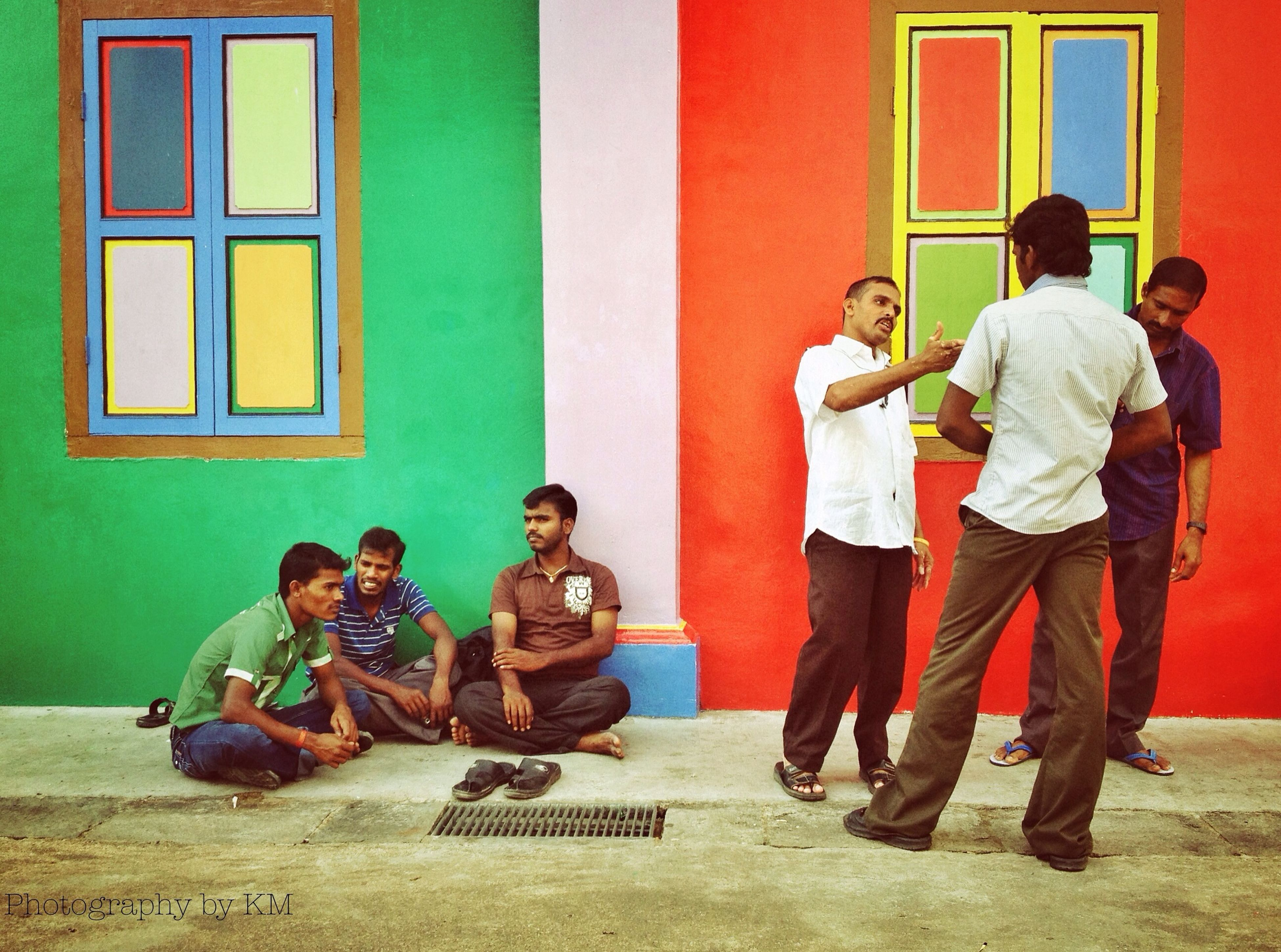 lifestyles, togetherness, leisure activity, full length, men, casual clothing, bonding, building exterior, sitting, architecture, boys, built structure, love, friendship, childhood, person, family