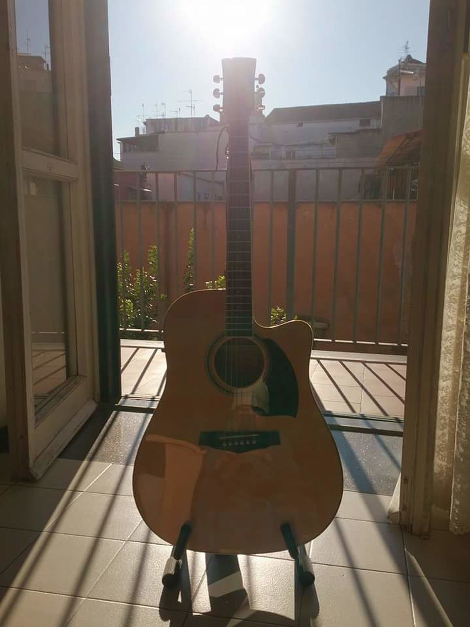 music, guitar, musical instrument, arts culture and entertainment, acoustic guitar, sunlight, day, no people, musical instrument string, architecture, indoors