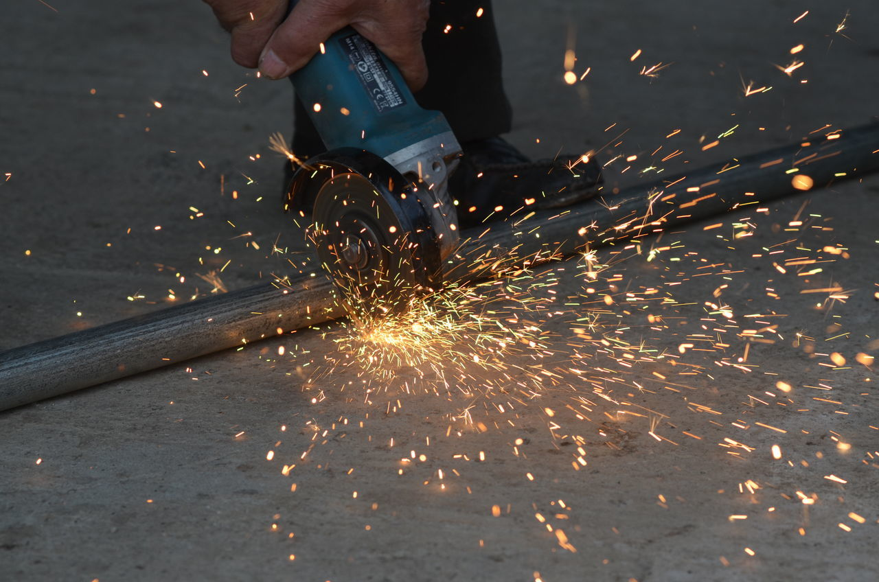 cutting metal with grinder Adult Adults Only Beam Cute Day Grinder Hot Industry Metal Metal Industry Metal Pipe Motion Occupation One Man Only One Person Only Men Outdoors People Pipe Sharp Sparkles ✨ Speed Tool Working