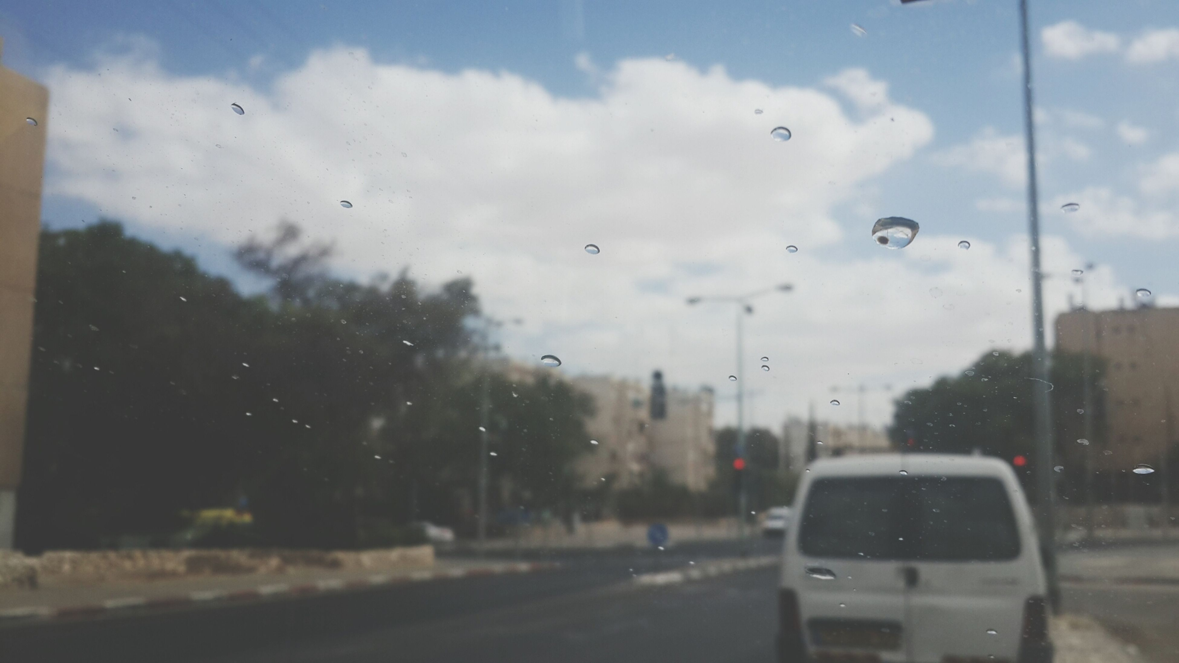 transparent, window, glass - material, transportation, wet, drop, car, rain, sky, mode of transport, land vehicle, vehicle interior, weather, water, indoors, season, road, raindrop, street, cloud - sky