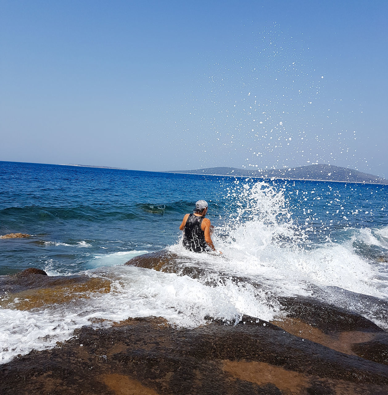 sea, horizon over water, motion, wave, nature, one person, water, splashing, beauty in nature, outdoors, sky, scenics, beach, day, clear sky, adventure, sport, healthy lifestyle, real people, adults only, men, power in nature, one man only, adult, people, sportsman, only men