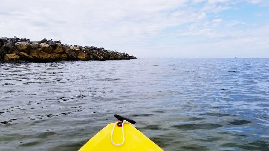 EyeEm Selects Yellow Beach Water Outdoors Tranquility No People Sea Buoy Day Summer Nature Kayak Landscape Nautical Vessel Sky Paint The Town Yellow
