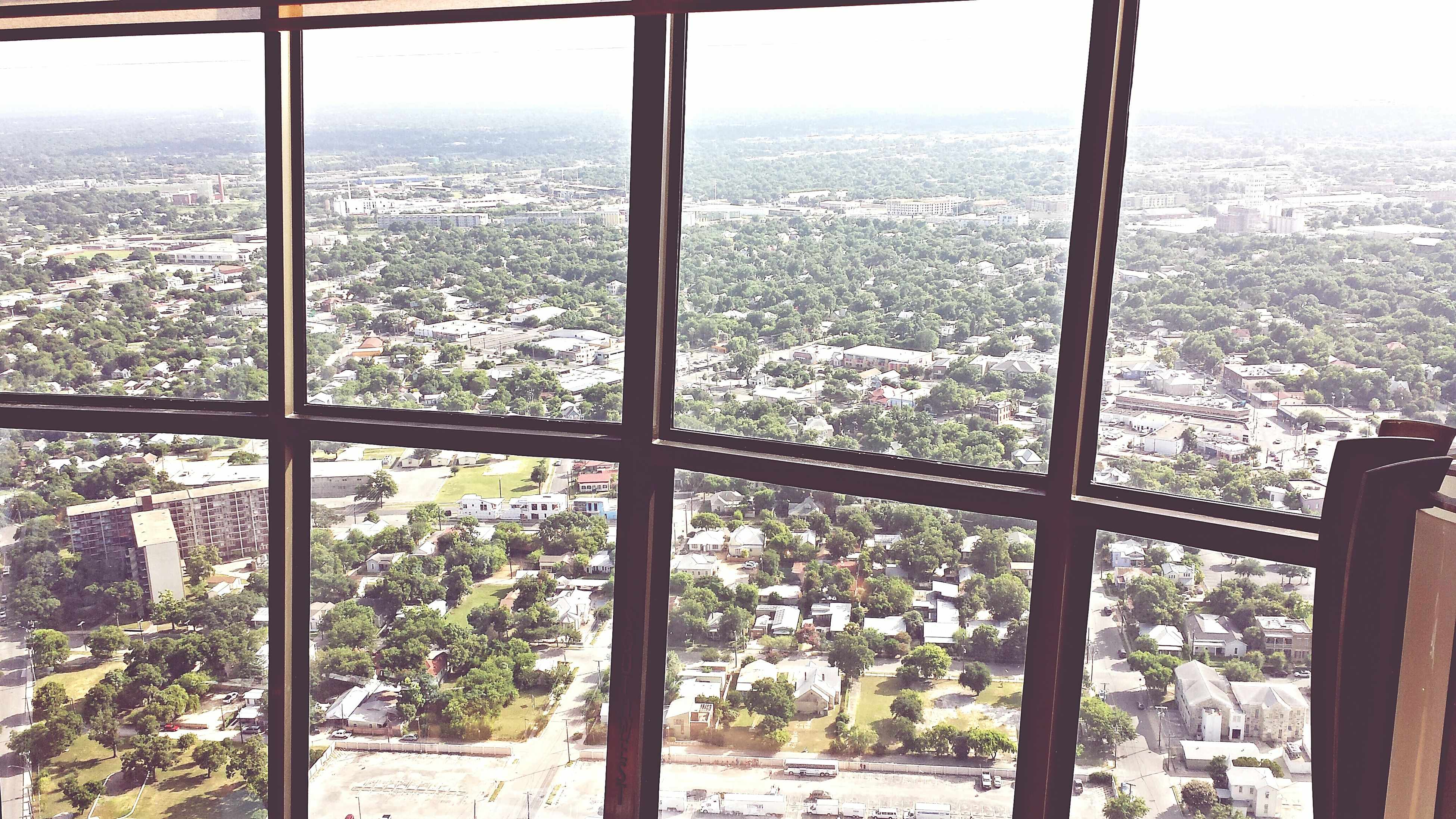 cityscape, city, window, indoors, transparent, architecture, built structure, glass - material, building exterior, crowded, sky, sea, day, high angle view, no people, residential district, glass, residential building, modern, skyscraper